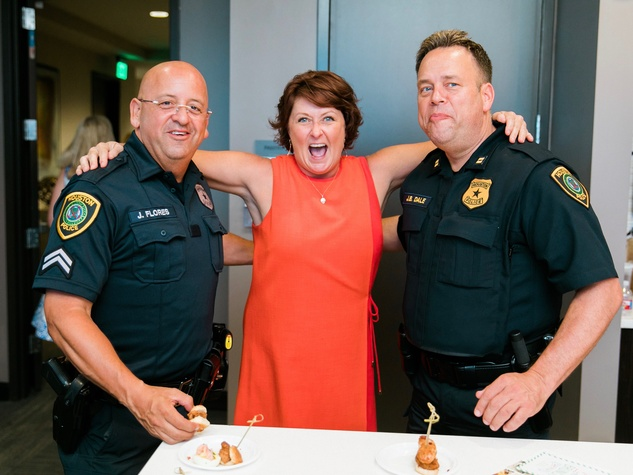 Lezlie Mahan and security officers at CultureMap Country Club Social