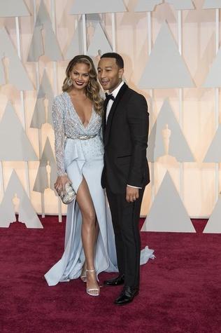 John Legend and Chrissy Teigen on red carpet at Oscars