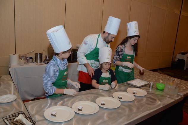 158 Cannolo Team from left Pier Francesco Papi, Veronica Pascucci, Executive Chef Fabio Potenzano and Giulia Sdingola at Tutti ai Fornelli de La Piccola Cucina March 2015