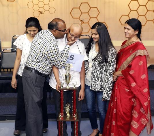 Houston Public Media Spelling Bee runnerup Raksheet Kota congratulated by his family