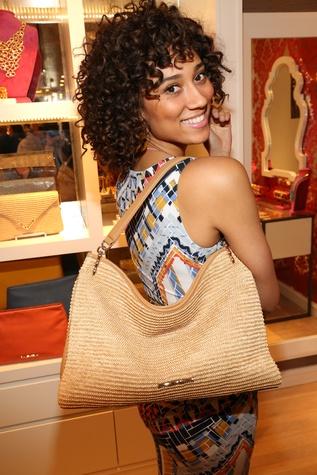 Model with Elaine Turner raffia handbag