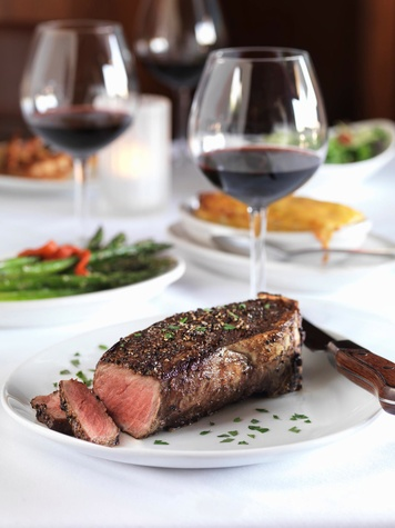 Fleming's Prime Steakhouse & Wine Bar peppercorn steak glass of wine