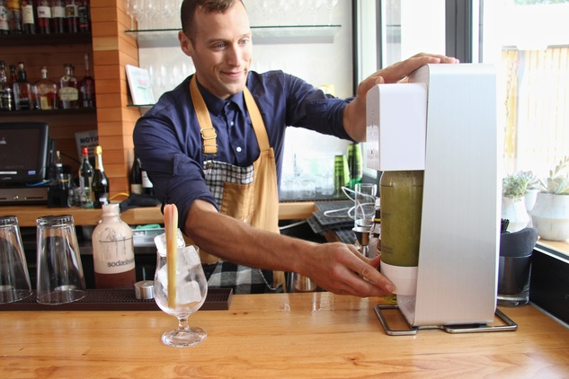 Michael Simon prepares celery ginger soda at Qui restaurant in Austin