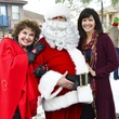 10 Warner Roberts, from left, Santa (Brian Hartland) and Angie Roberts at Mission of Yahweh's gift-giving celebration December 2013