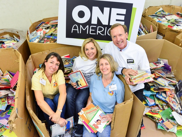 Amy Barnes, from left, Julie Baker, Sandra Ahlhorn and Neil Bush at the Books Between Kids project November 2013