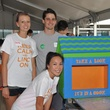 19 Britni Keith, from left, Aaron Pelletier and Diana Dao at young professionals build Tiny Libraries September 2014
