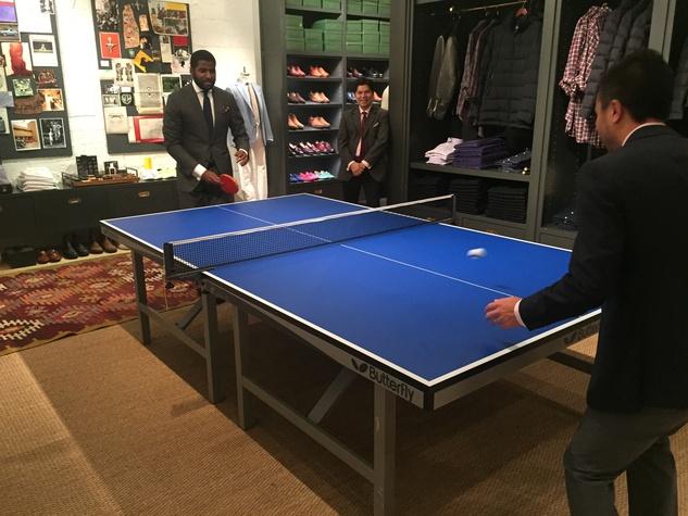 Playing ping-pong at Sid Mashburn + Ann Mashburn Houston Anniversary Party December 2014