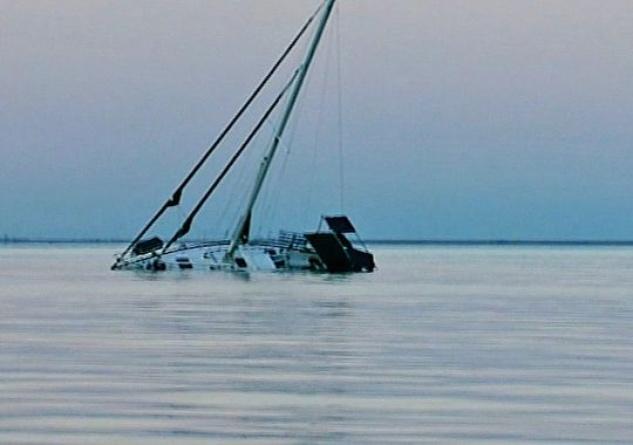 sinking sailboat in galveston bay