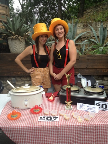 Quesoff IV competitors with cheese hats