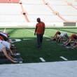 Ricky Williams leading yoga class at DKR