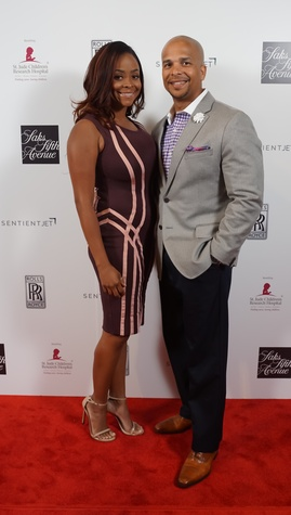Dr. Ashandra Batiste, Richard Cumby at Saks Fifth Avenue Super Bowl party