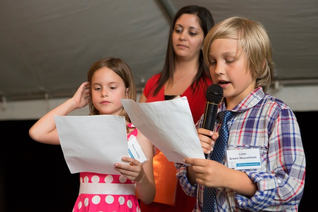 Students from UT Elementary reading thank you letters at the Colorado River Alliance 12th Annual Cocktails on the Colorado Gala