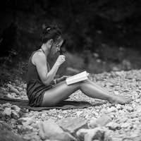 Woman reading book beach