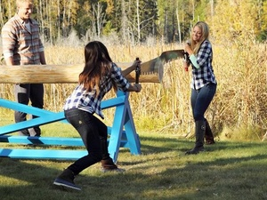 Girls cut logs on the Bachelor
