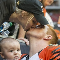 25 Texans vs. Bengals Andy Dalton after the game…He went over to the sidelines and his wife Jordan came down, handed him their son, Noah and then kissed him