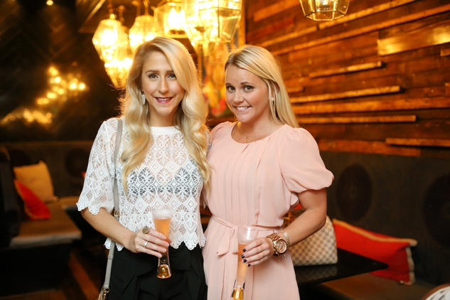Andrea Simmons, left, and Jayme Lamm at Ruggles Black Grand Opening October 2014