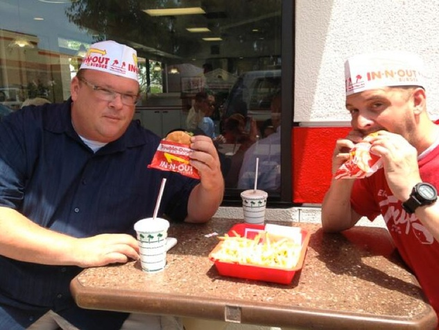 Chris Shepherd eating an In-N-Out Double Double burger with Underbelly sous chef Ryan Lachaine June 2013