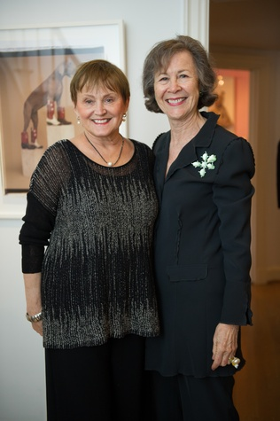 Anne Graubart and Kathryn Rabinow with the William Wegman photograph in background at Planned Parenthood Fine Art Auction