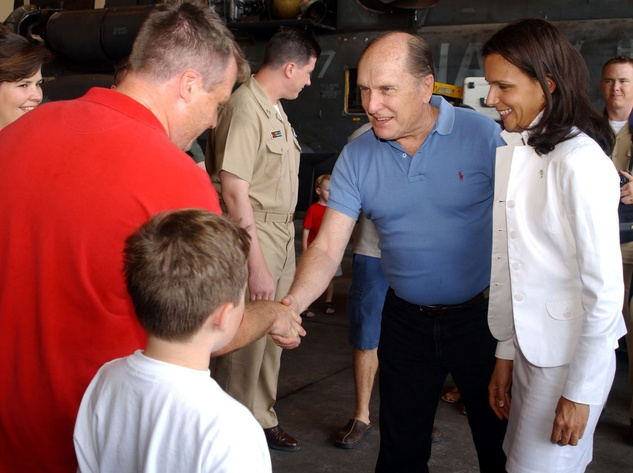 """Duvall with future wife Luciana Pedraza (right) shaking hands with a member of the """"The Black Stallions"""" of Helicopter Combat Support Squadron Four at the Taormina Film Fest in Sicily in June 2003"""