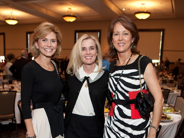 243 Chris Mizell, from left, Dana Burke and Cindy Holmes at the Hope and Healing Center luncheon May 2014