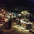 The Pass & Provisions patio at night with people