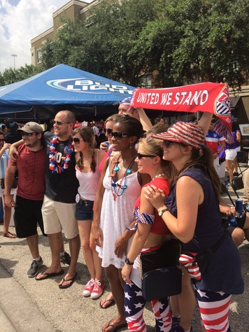USA soccer fans decked out in red, white and blue from head to toe.