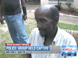 eight people found held captive in Houston home July 2013 MAN