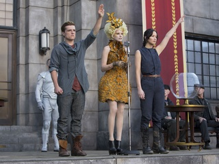 Josh Hutcherson, Elizabeth Banks and Jennifer Lawrence in The Hunger Games: Catching Fire