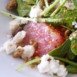 Lucille's watermelon salad with baby arugula, iced red onion, crushed pistachio and feta