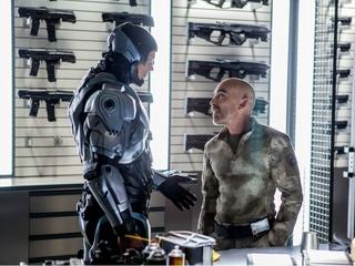 Joel Kinnaman and Jackie Earle Haley in Robocop
