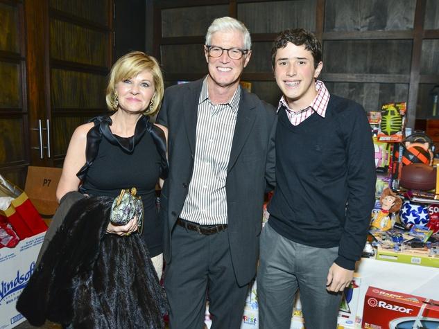 9 Sheri Feldman, from left, Mark Faigen and Liam Faigen at Joyful Toyful December 2013