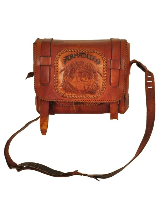 Eddie Wilson_Armadillo World Headquarters_Threadgill's_auction_Burley Auction Gallery_leather briefcase