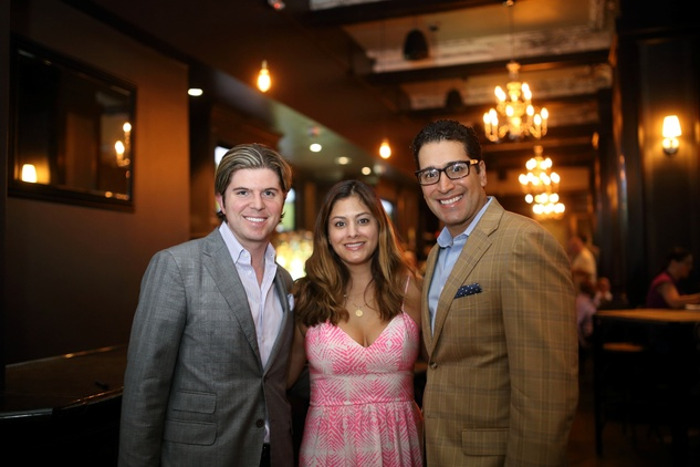Nathan Reedy, from left, Katherine Ross and Josh Espinedo at the Springbok restaurant kick-off party July 2014