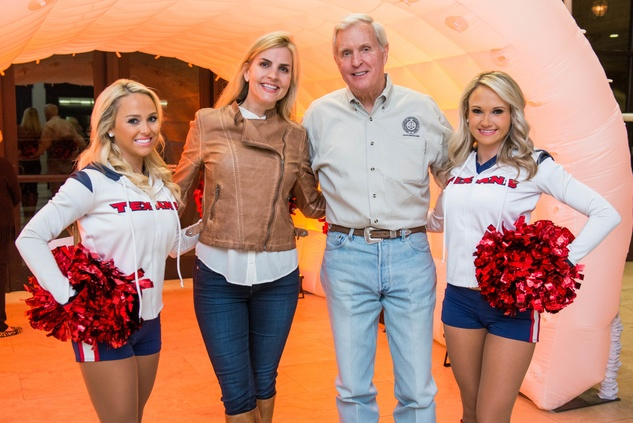 159 Texans Cheerleader Kristy, from left, Joanie and Doug McLeod and Texans Cheerleader Kim at the Camp For All Super Ball February 2015