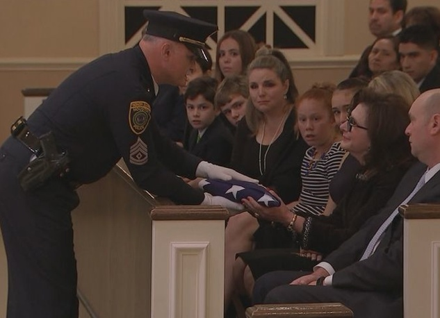Elyse Lanier recieves flag at funeral of Bob Lanier